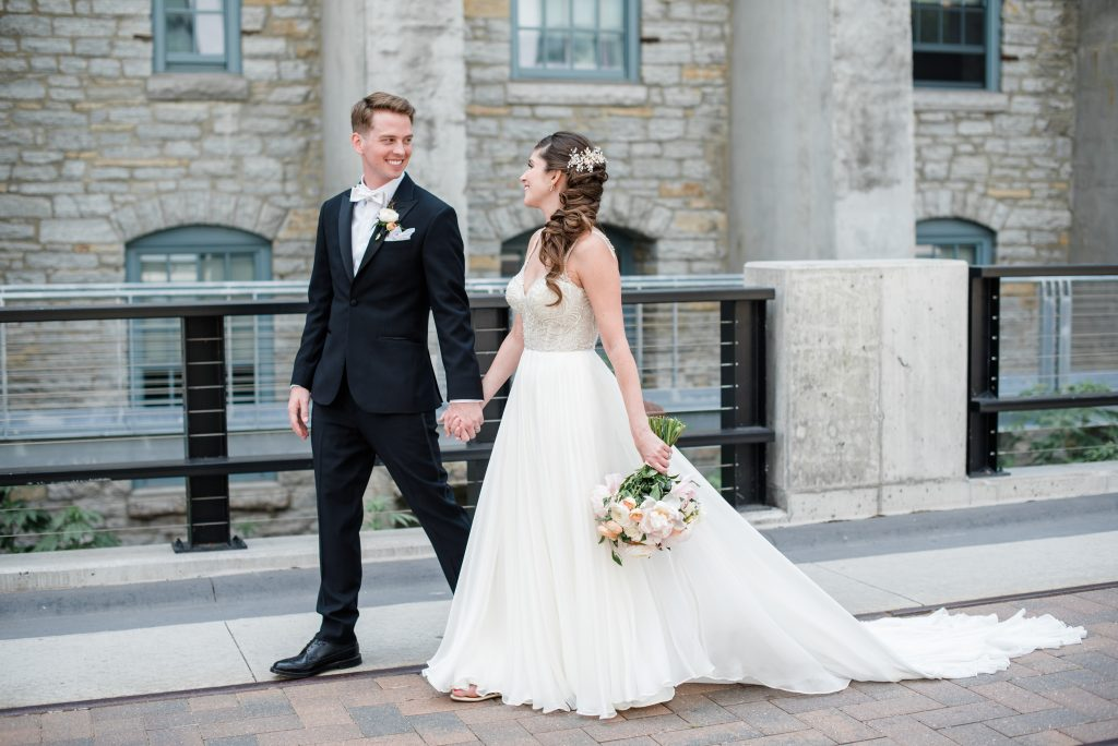 A bride and groom walking